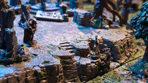 A wizard awaits the top of the winding escarpment for the adventurer