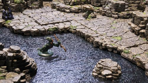 The lizardfolf swims to shore from the mountain spring water to the stone ledges leading to dry land