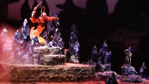 The wizard pays homage to the fiery elemental Myrmidon