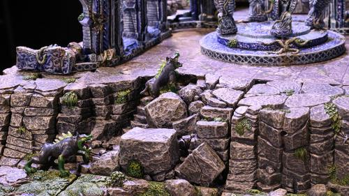 Blink dogs ascend the winding stairs in the rocky escarpment to find ancient ruins