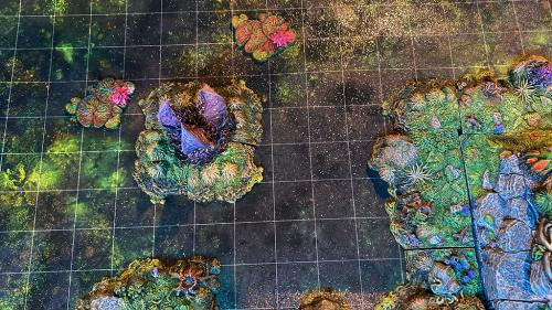 One inch grids in the textured mat artwork help games map out movement on swamp terrain