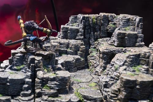 A weretiger climbs an expansive cliff